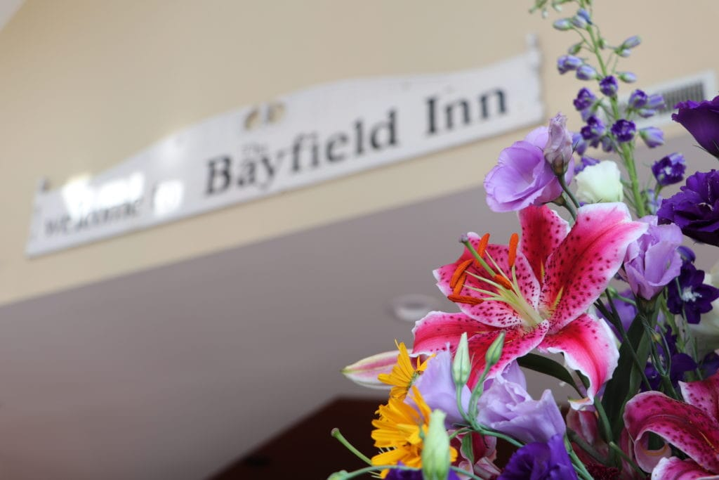 bayfield inn sign and flowers